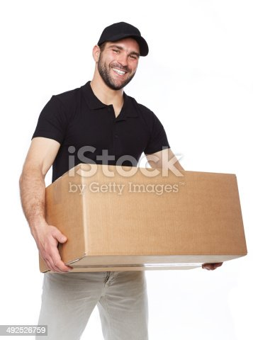 istock Smiling delivery man giving cardbox 492526759