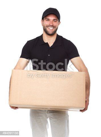 istock Smiling delivery man giving cardbox 494091135