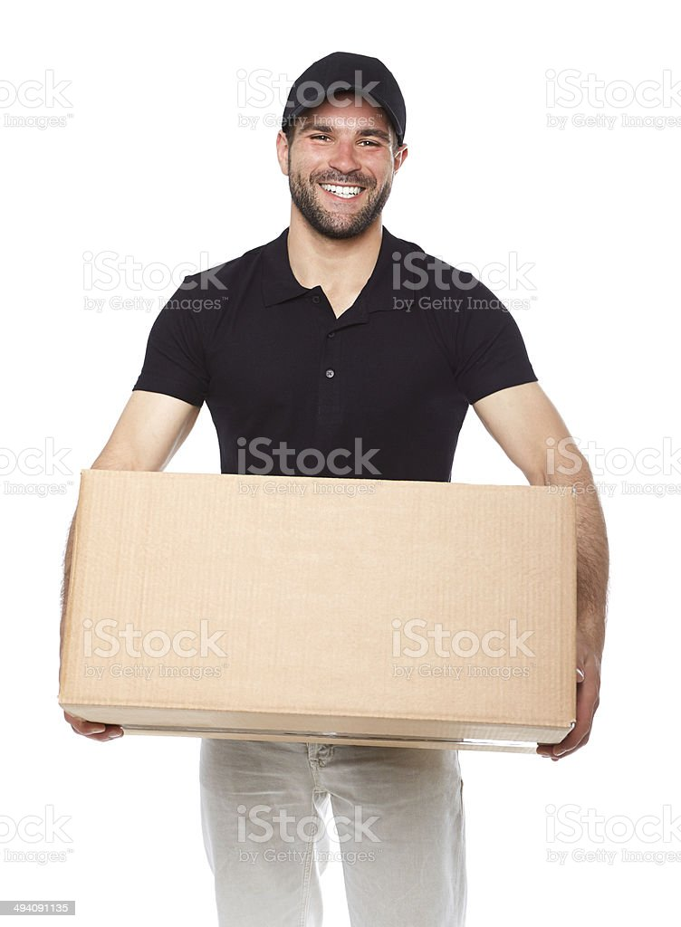 Smiling delivery man giving cardbox stock photo