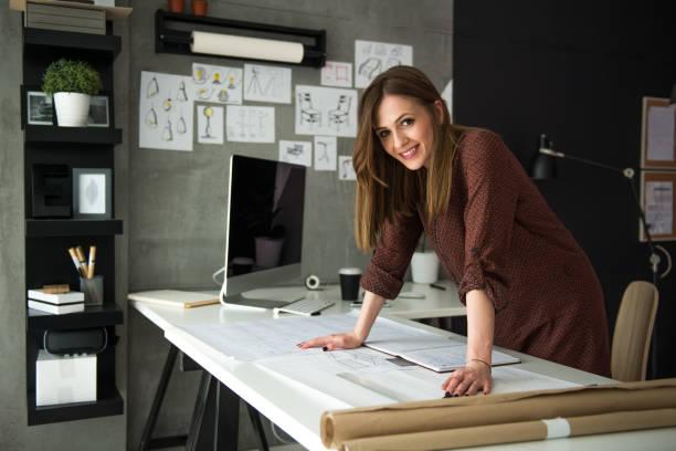 Smiling designer in her studio stock photo