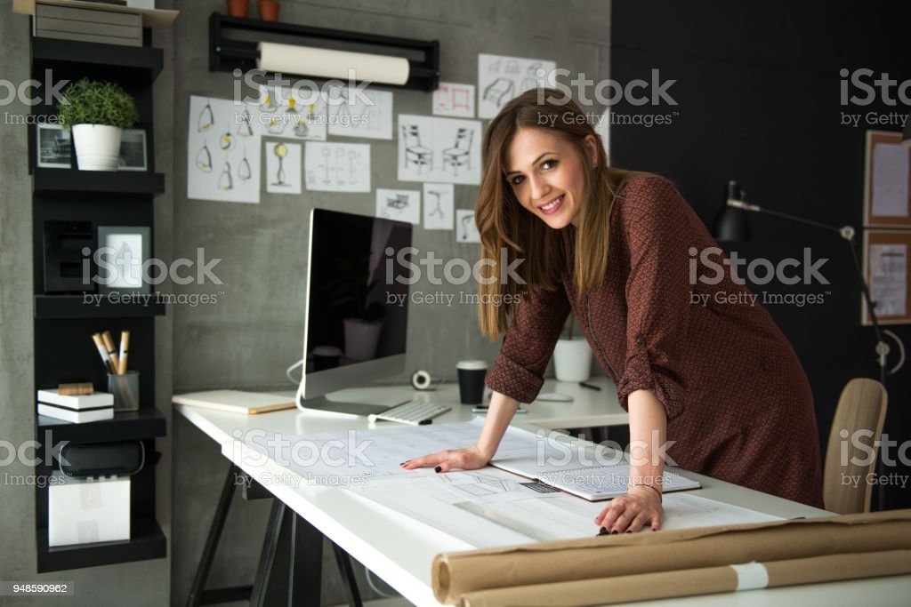 Smiling designer in her studio stock photo