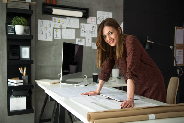 smiling designer in her studio - owner stock pictures, royalty-free photos & images