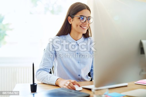 istock Smiling digital artist working on computer 682384762