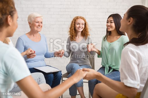 866758230 istock photo Smiling Diverse Women Sitting In Circle During Group Therapy Indoor 1178527420