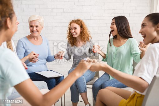 866758230 istock photo Smiling Diverse Women Sitting In Circle During Group Therapy Indoor 1178924024