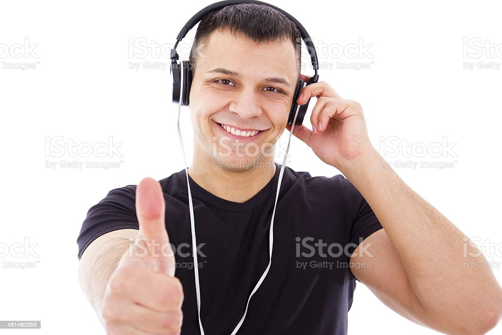 smiling dj with headphones showing thumbs up stock photo
