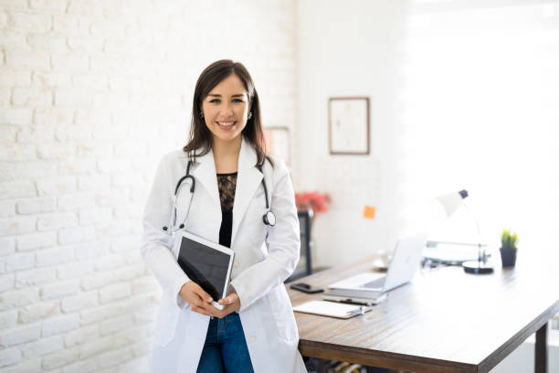 smiling doctor at her clinic - dietician stock pictures, royalty-free photos & images