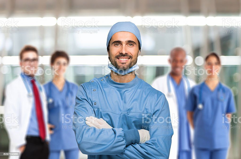 Smiling doctor in front of his team stock photo