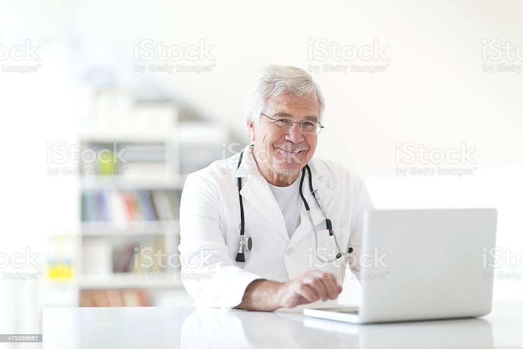 Smiling doctor in his office royalty-free stock photo