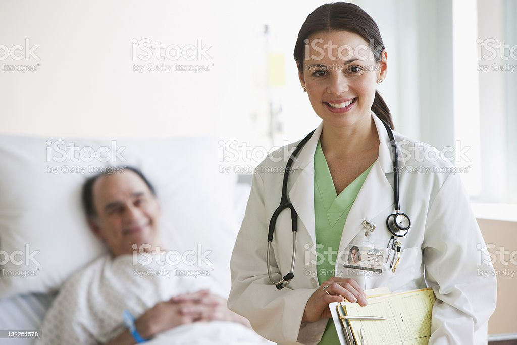 Smiling doctor n hospital with older patient royalty-free stock photo