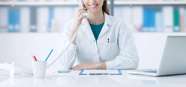 Smiling doctor on the phone