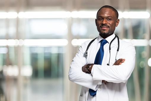 istock Smiling doctor portrait 470691572