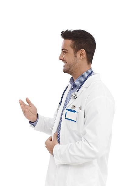 Smiling doctor talking stock photo