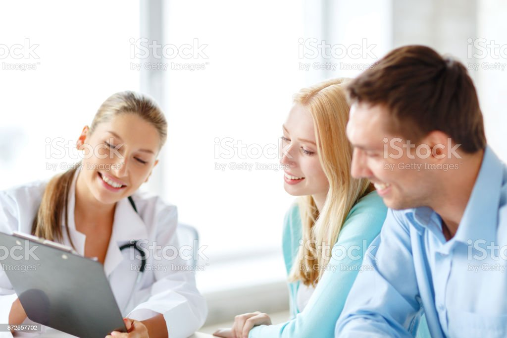 smiling doctor with patients in hospital stock photo