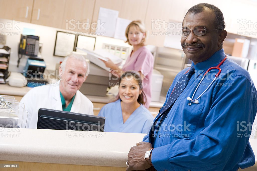 Smiling doctors and nurses at a reception area royalty-free stock photo