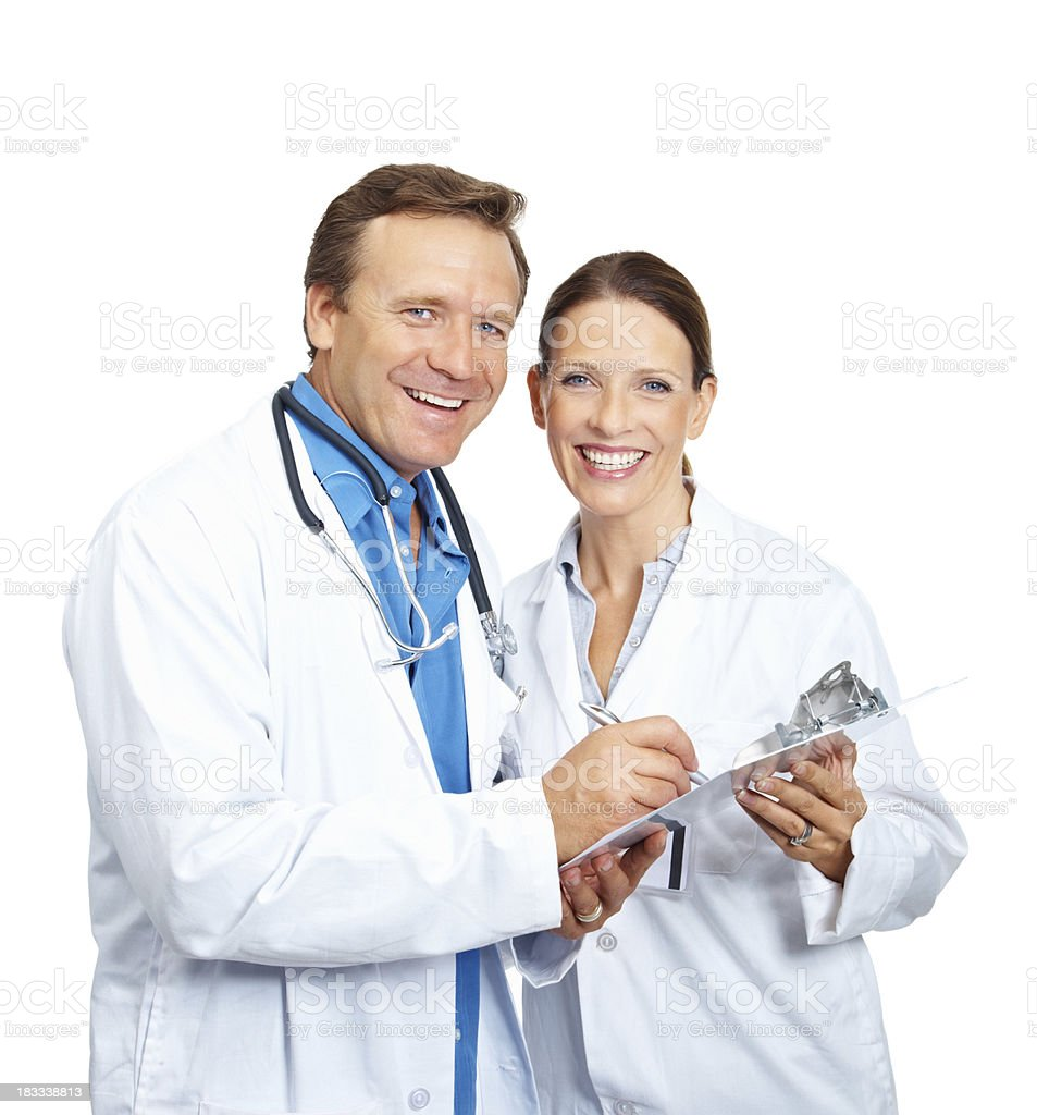 Smiling doctors discussing over reports isolated royalty-free stock photo