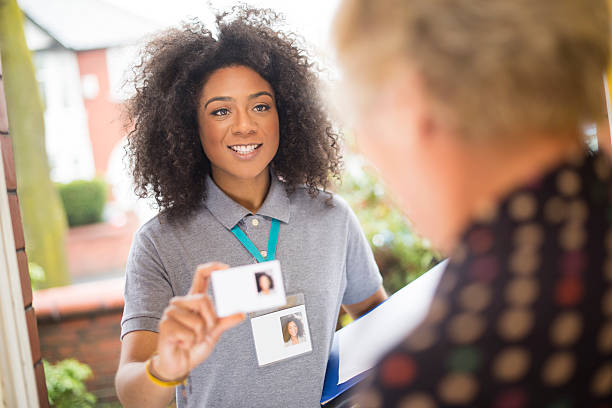 smiling door knocker - identity card stock photos and pictures