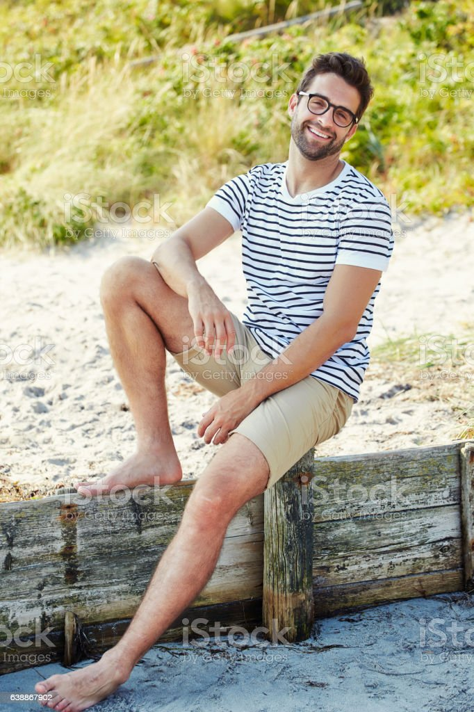 Smiling dude on beach stock photo