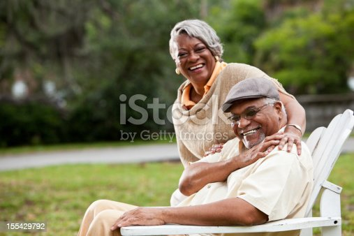 istock Smiling elderly African-American couple in park 155429792