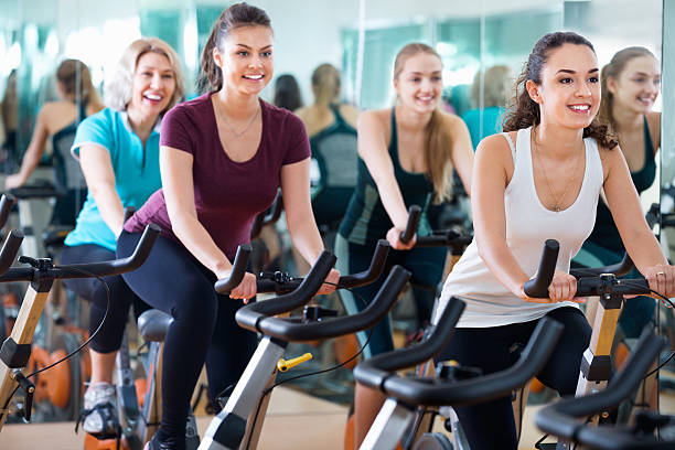 Smiling elderly and young women working out hard stock photo