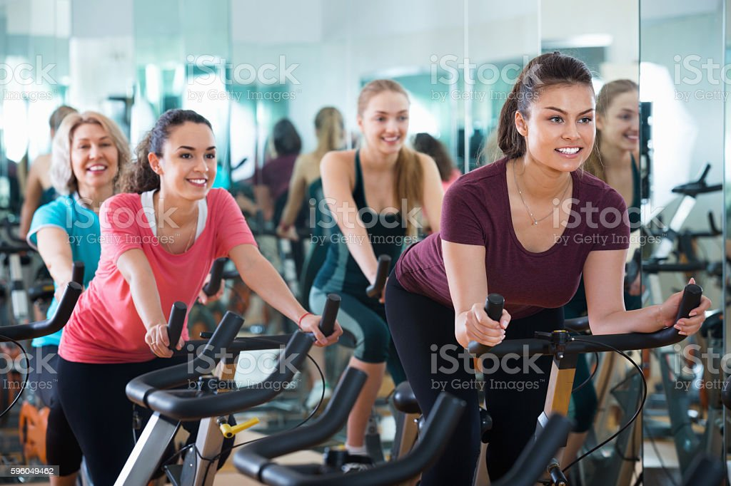 Smiling elderly and young women working out hard royalty-free stock photo