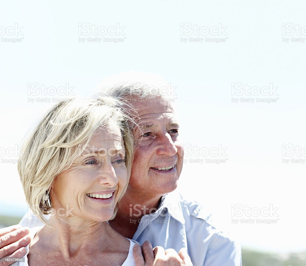 Smiling elderly couple looking away royalty-free stock photo