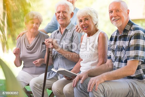 istock Smiling elderly people at patio 876906352