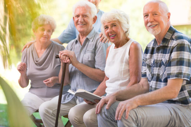 Smiling elderly people at patio stock photo