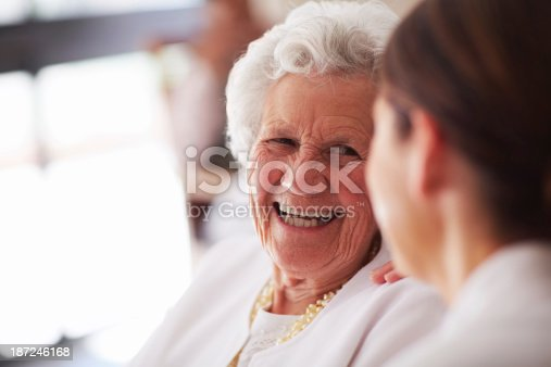 istock Smiling elderly woman and female nurse 187246168