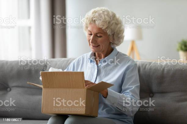 Smiling elderly woman customer receive post shipment parcel at home picture id1189198077?b=1&k=6&m=1189198077&s=612x612&h=tqx1mihfgcupclaaldpau5vc3izzorhd714clqot31g=