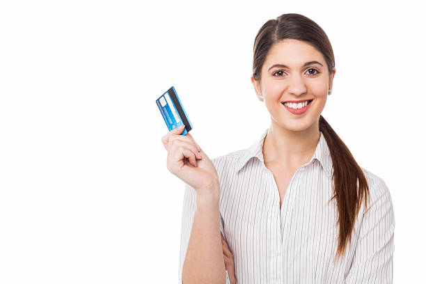 Smiling elegant woman holding credit card stock photo