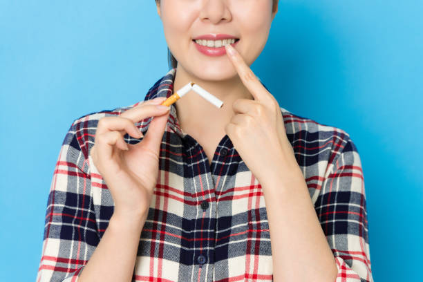 smiling elegant woman pointing personal tooth stock photo