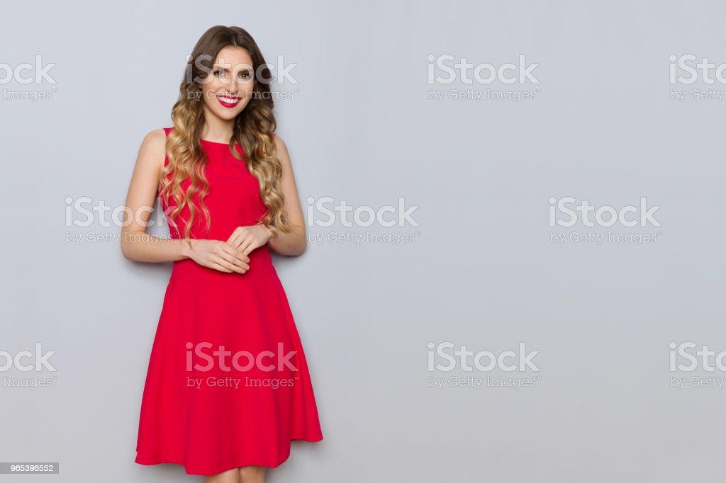 Smiling Elegant Young Woman In Red Dress zbiór zdjęć royalty-free