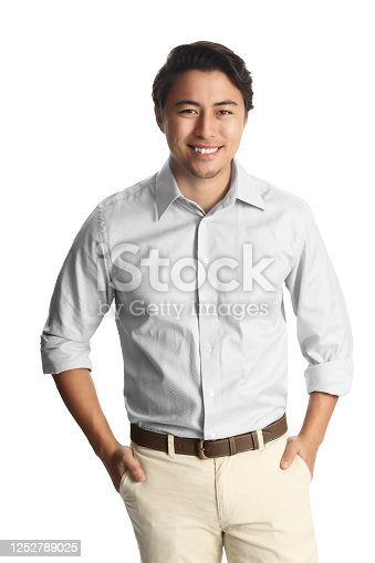 A successful asian male entrepreneur smiling confidently with both hands in his pocket wearing a white collared shirt isolated against a white background.