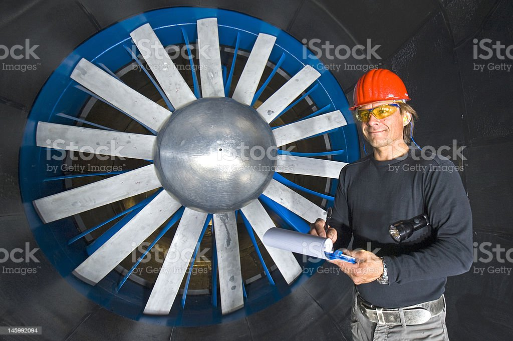 Smiling Engineer in a Windtunnel stock photo