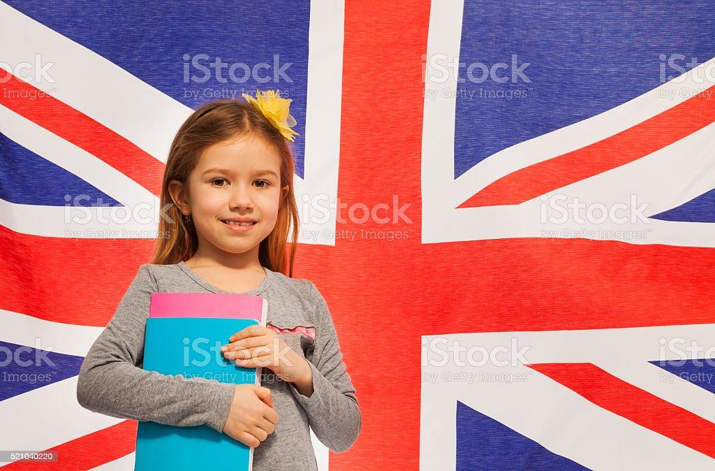 Écolière avec livres souriant anglais - Photo