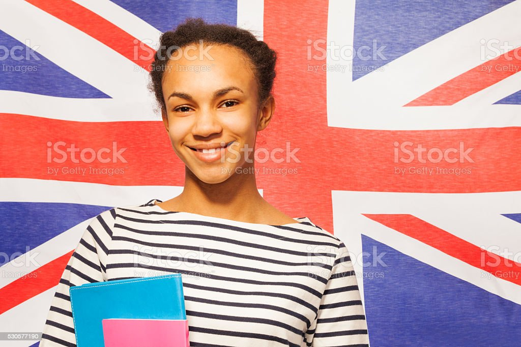 Smiling English student with textbooks stock photo