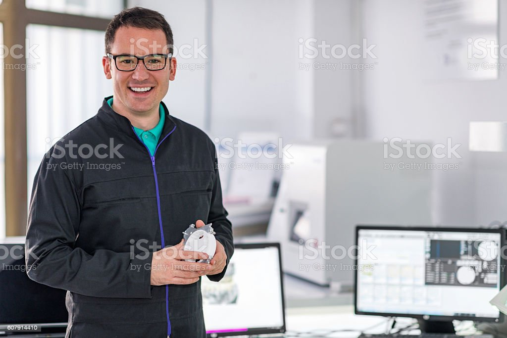Smiling esthetic dentist in his office stock photo