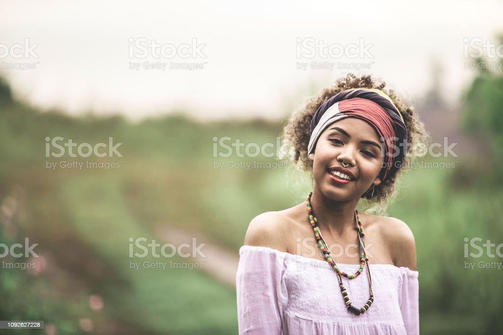 Concept of hippie lifestyle. Close up portrait of happy smiling...