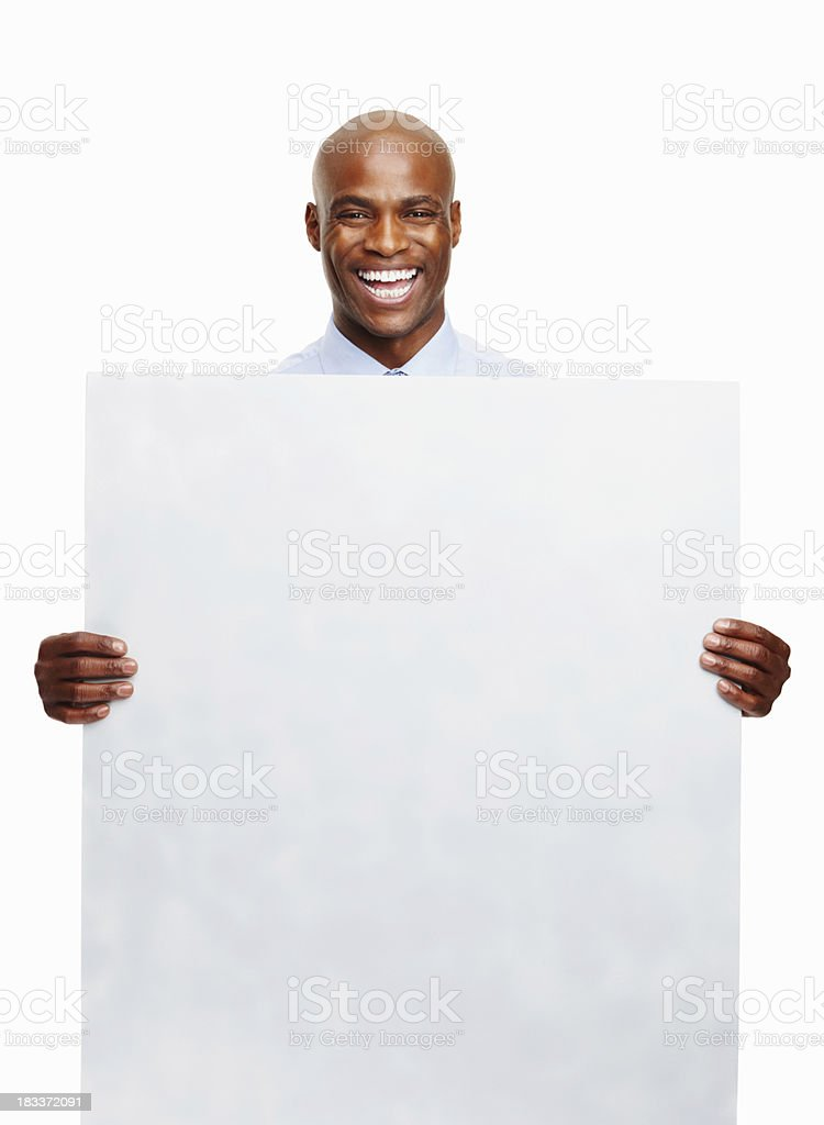 Smiling executive showing a blank card royalty-free stock photo