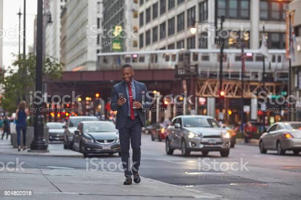Smiling executive using smart phone on city street picture id924802018?b=1&k=6&m=924802018&s=612x612&h=hebjwap7kgp5eqy1cal1tk9y9kknjudphqmzlwiiikm=