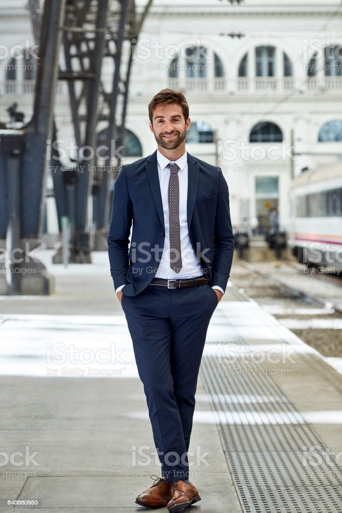 59b60876b4d0 Smiling Executive With Hands In Pockets At Station Stock Photo ...