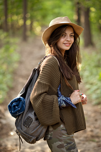 Smiling Explorer Standing With Backpack In Forest Stock Photo - Download Image Now