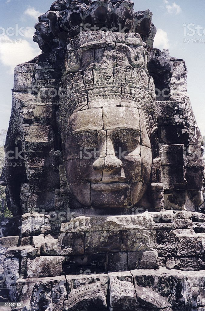 Smiling face carved in rock royalty-free stock photo