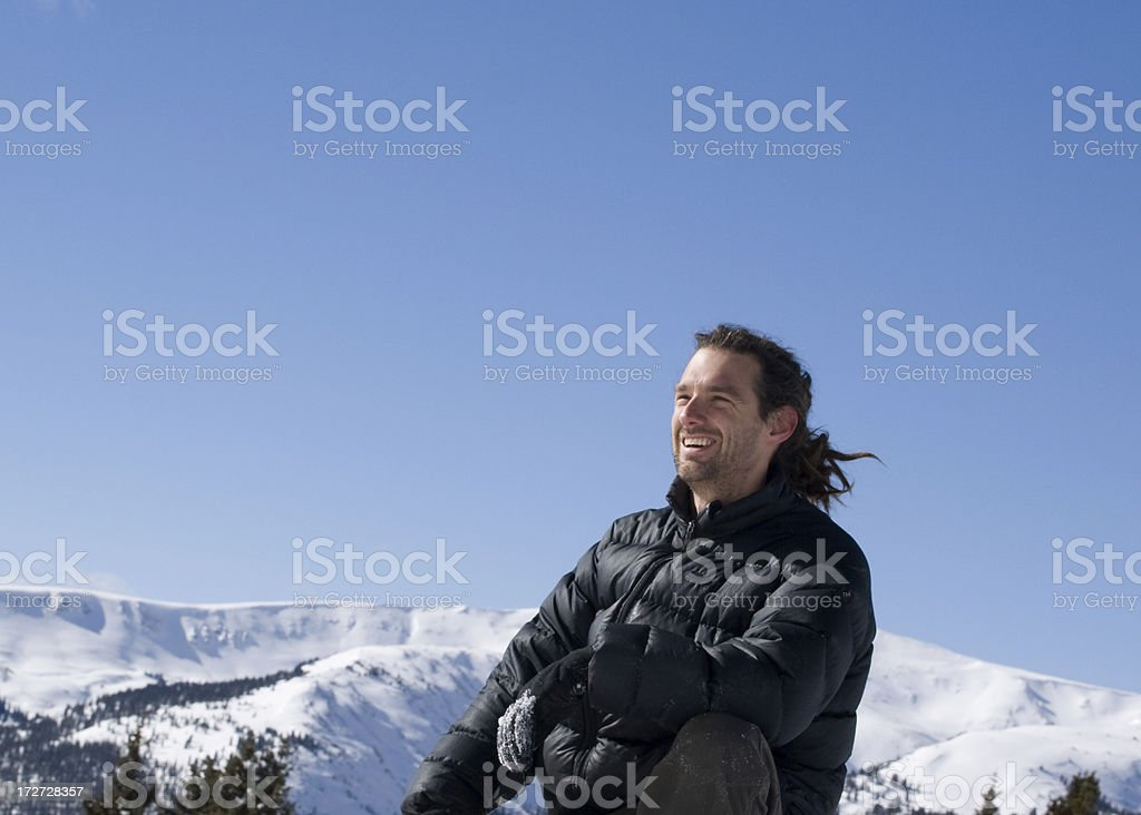 Smiling face of successfully reaching the peak royalty-free stock photo