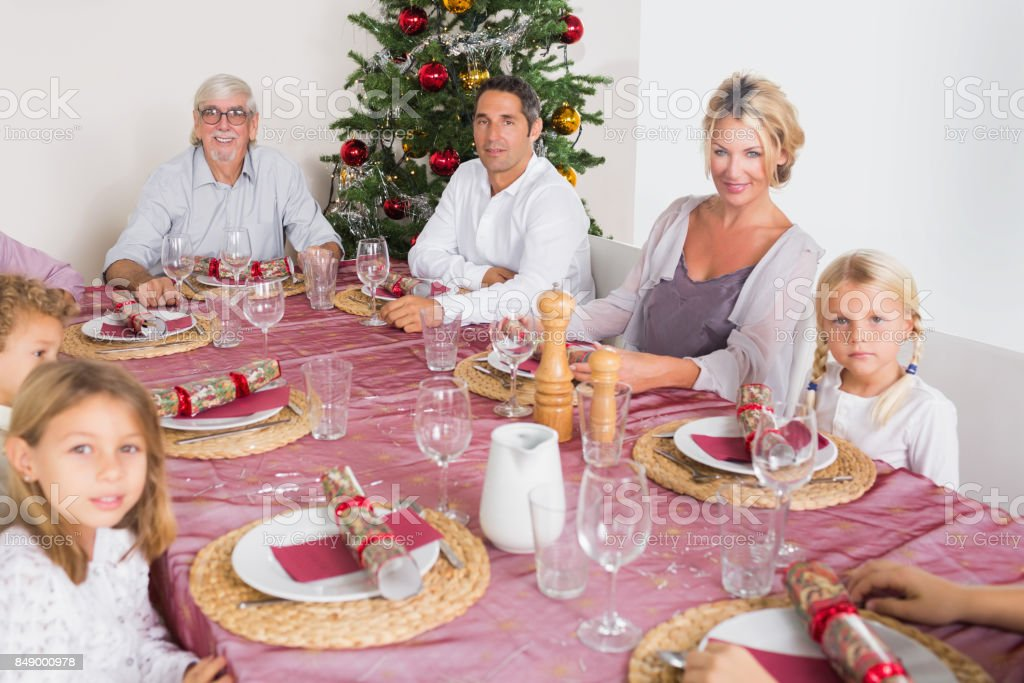 Smiling family at the dinner table stock photo
