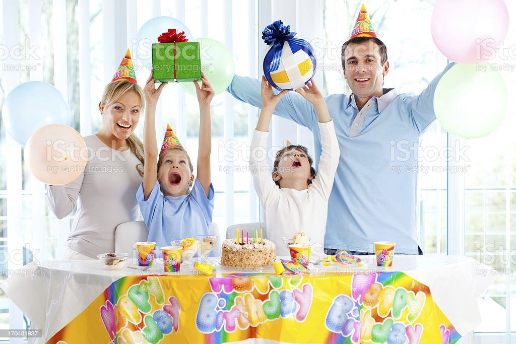 Smiling family celebrating their children's birthdays. royalty-free stock photo