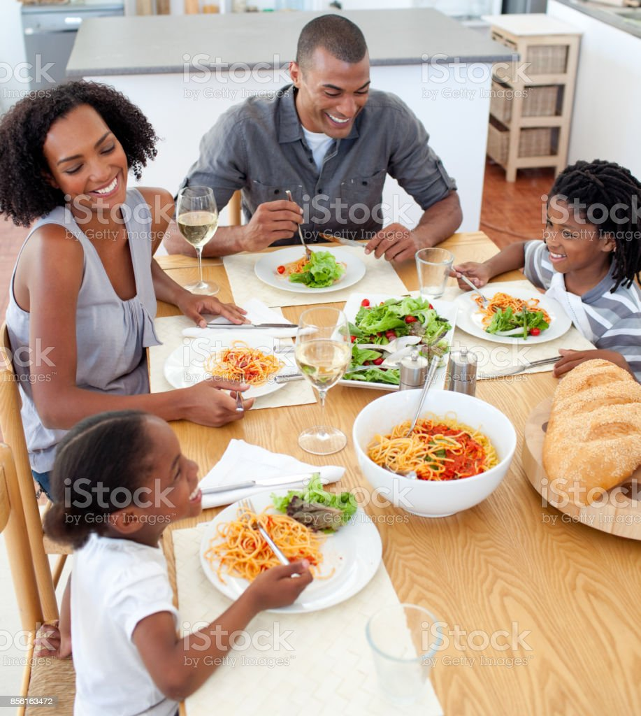 Smiling family dining together stock photo