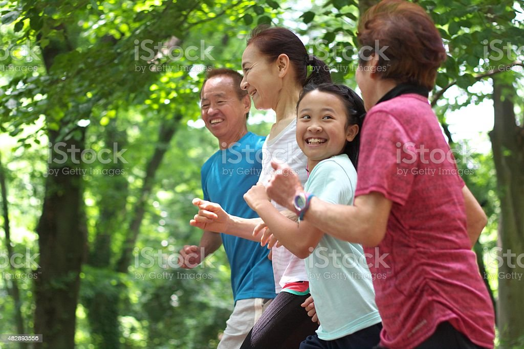 Smiling family jogging together stock photo