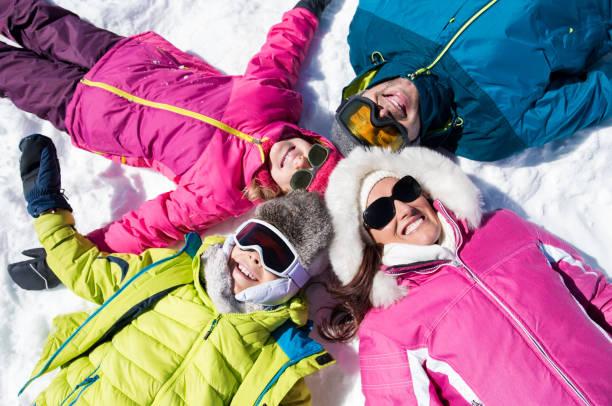 Smiling family lying on snow picture id831418562?b=1&k=6&m=831418562&s=612x612&w=0&h=7iokvmgbrw6tkt4wuucjnqztp9  m r3tnih1cfrzmy=